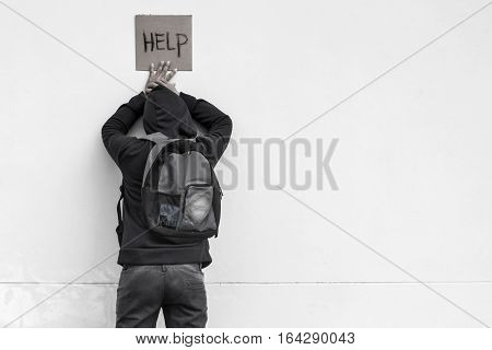 Homeless person with help sign,Poverty issue concept
