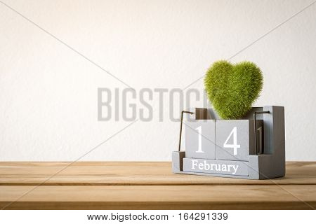 Vintage Wood Calendar For February 14 With Green Heart On Wood Table Love And Valentine's Day Concep