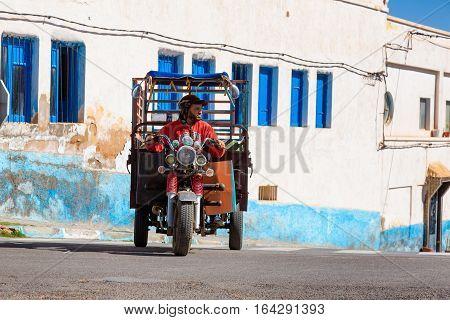 Sidi Ifni, Morocco - November 11, 2016: Scenes Full Of Colors In Moroccan Streets.