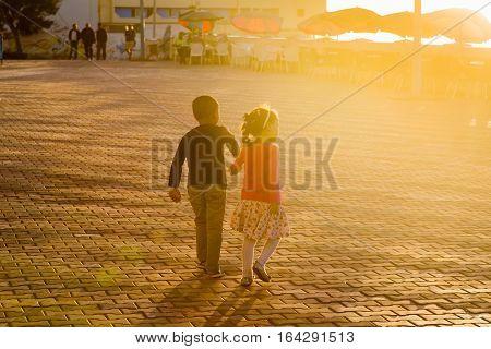 Sidi Ifni, Morocco - November 09, 2016: Rendezvous On The Promenade At Sunset