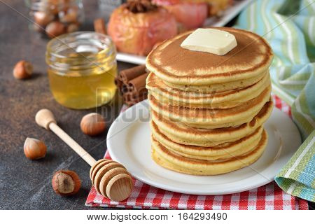Pancakes with honey for breakfast close up