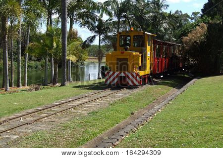 Small yellow narrow gauge diesel train operating tourist services
