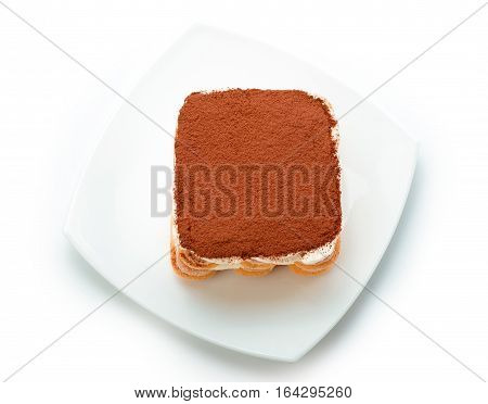 Tiramisu on white plate isolated. Clipping path. Top view.