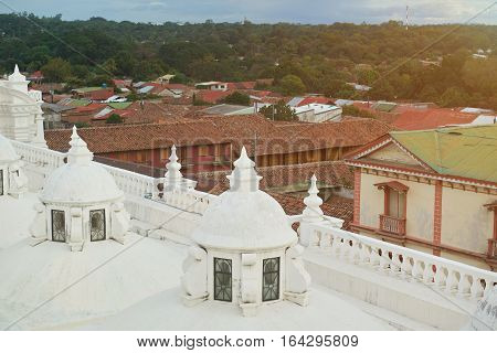 Houses in Leon city NIcaragua. Cityscape of touristic Leon city with cathedral roof