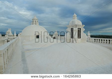 Towers on white church roof on sunset light time