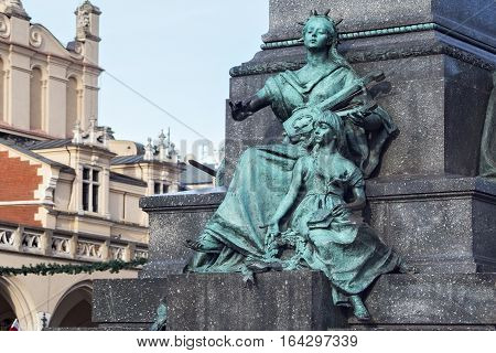 POLAND KRAKOW - JANUARY 03 2015: Muse of Poetry with child as element of Adam Mickiewicz Monument in the Main Market Square. It was designed by Teodor Rygier in 19th century.