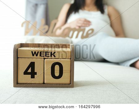 Calendar with weeks 40 of pregnant with pregnancy woman background. Maternity concept. Expecting an upcoming baby. Due date countdown.