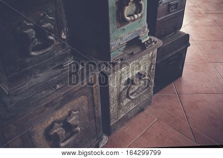 Old Antique Iron And Wood Travel Chest In A Stack Used In The Past With Toned Image As Vintage Backg