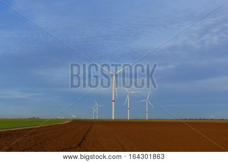 This is a wind turbines park in Oberwichterich. The coal-fired power plant is quite small in the background