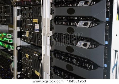Several racks of servers in the data center server room
