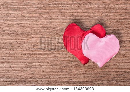 Top View Of Two Red And Pink Hand-sewn Heart On Wooden Background, Concept Valentine's Day, Greeting