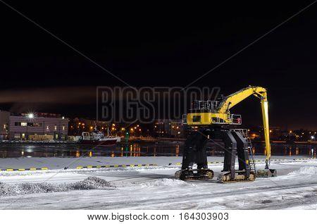 Hydraulic manipulator waiting for work - port of Ventspils Latvia