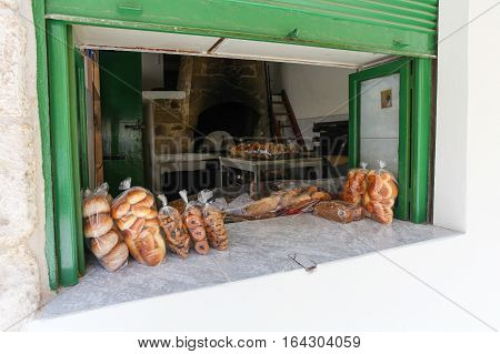 Rethymnon, Island Crete, Greece- July 1 2016: Window of bakery with fresh and tasty muffins pastry and bread on the street of the old town's part of city Rethymnon