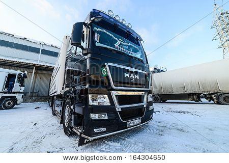 Moscow, Russia - December 13, 2016: Warehouse transport and logistics company. Truck are on the loading at the warehouse. Freight transport.