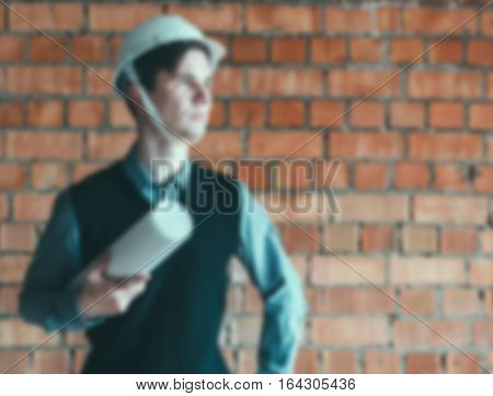 Blurred defocused photo portrait of the engineer