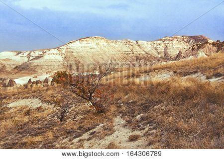 Landscape at Cappadocia Turkey. Cappadocia with its valley ravine hills located between the volcanic mountains in Goreme National Park.