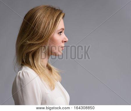 Profile Portrait Of A Beautiful Blonde Woman