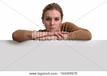 Young Woman Leaning On Big Blank Board