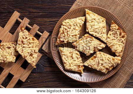 Homemade shortbread cookies with jam on dark wooden table top view