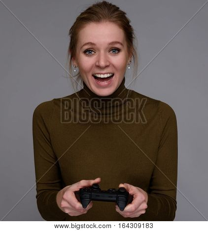 Girl Playing Computer Game With A Gamepad