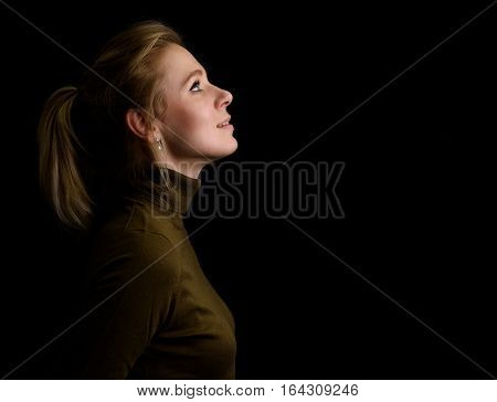 Side View Of A Beautiful Young Woman