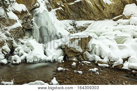 Icy Hardy Falls and stream Peachland in Okanagan valley near Kelowna British Columbia Canada in the winter with snow