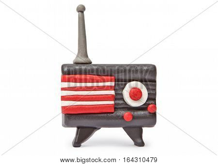 Plasticine vintage transistor radio isolated on white background