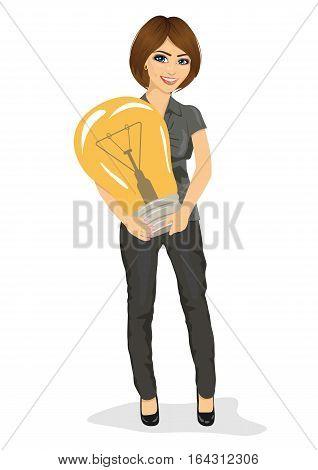 Beautiful businesswoman holding a big light bulb. Big idea concept