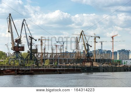 Nizhny Novgorod. Port cranes on the Strelka and the construction of stadium for the World Cup
