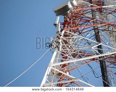 COLOR PHOTO OF TELECOM WORKERS REPAIRING CABLES ON TOWER