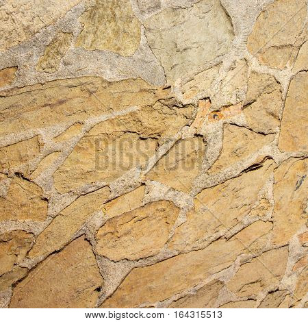 Natural Grunge Decorative Stone Wall Background. Abstract Rough Stonewall Surface Rock Texture Square Image Close up