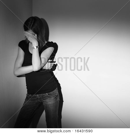 Young woman suffering from severe depression (B&W image)