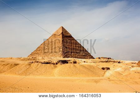 The Giza pyramid complex is an archaeological site on the Giza Plateau on the outskirts of Cairo Egypt.