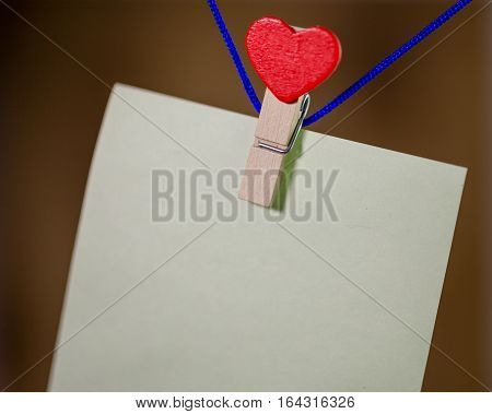 Heart Clothes Peg Holding Note