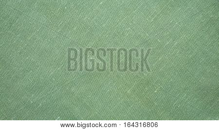 Natural Rough Flax Diagonal weave Fabric Cloth texture. Pale Green textile Background or Wallpaper close up. Web banner Wide Horizontal Image With Copy Space