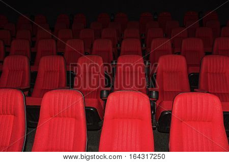 The empty movie theater with red seats