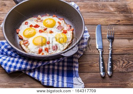 Fred eggs in pan with tomatoes. Breakfast. Healthy food.