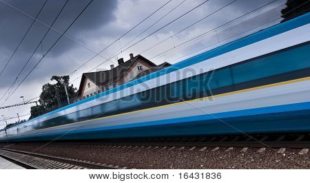 Fast train passing by (motion blur is used to convey movement; color toned image)
