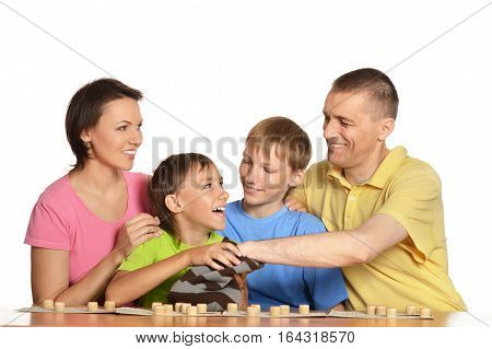 Portrait of a family playing loto together, against white