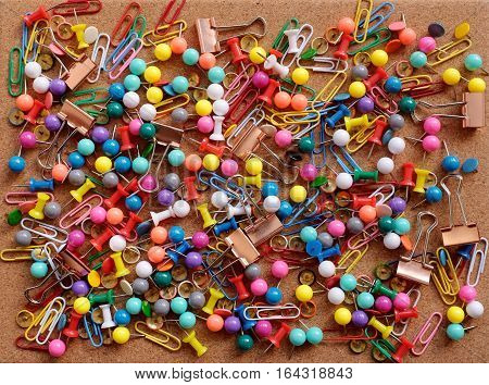 Background Of Drawing Pins, Paper Clips And Binder Clips