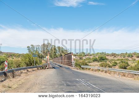 The historic single lane bridge over the Rietrivier (reed river) at Koffiefontein a diamond mining town in the Free State Province