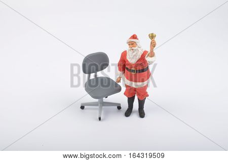 Santa Clauses Figure With Chiar