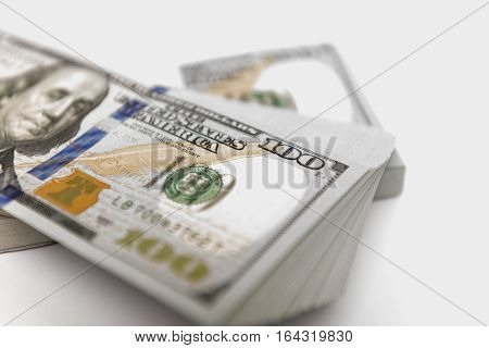 Stack of cash money in hundred dollar banknotes