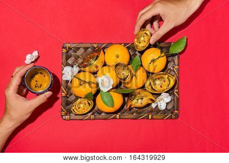 Chinese new year's decoration. Mandarin orange and gold sycee. Text mean Rich.