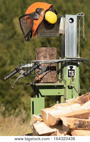 Electric log splitter with wood and trunks