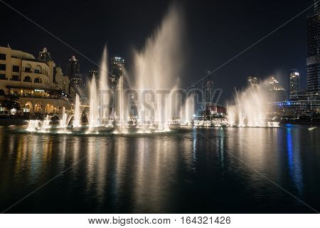 DUBAI UNITED ARAB EMIRATES - DECEMBER 7 2016: The Dubai Fountain at night. It is a dance show of water reaching up to 140 metres high accompanied by syncing lights and music.