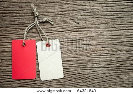 Two tags on the wooden table background.