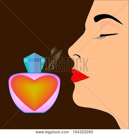 Perfume bottle and profile of woman's face on dark background