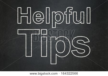 Studying concept: text Helpful Tips on Black chalkboard background
