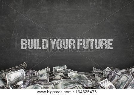 Build your future text on black background with dollar pile
